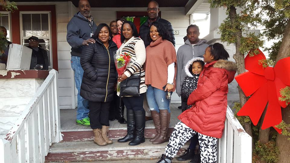 The Burkes family with ACTS Housing team members