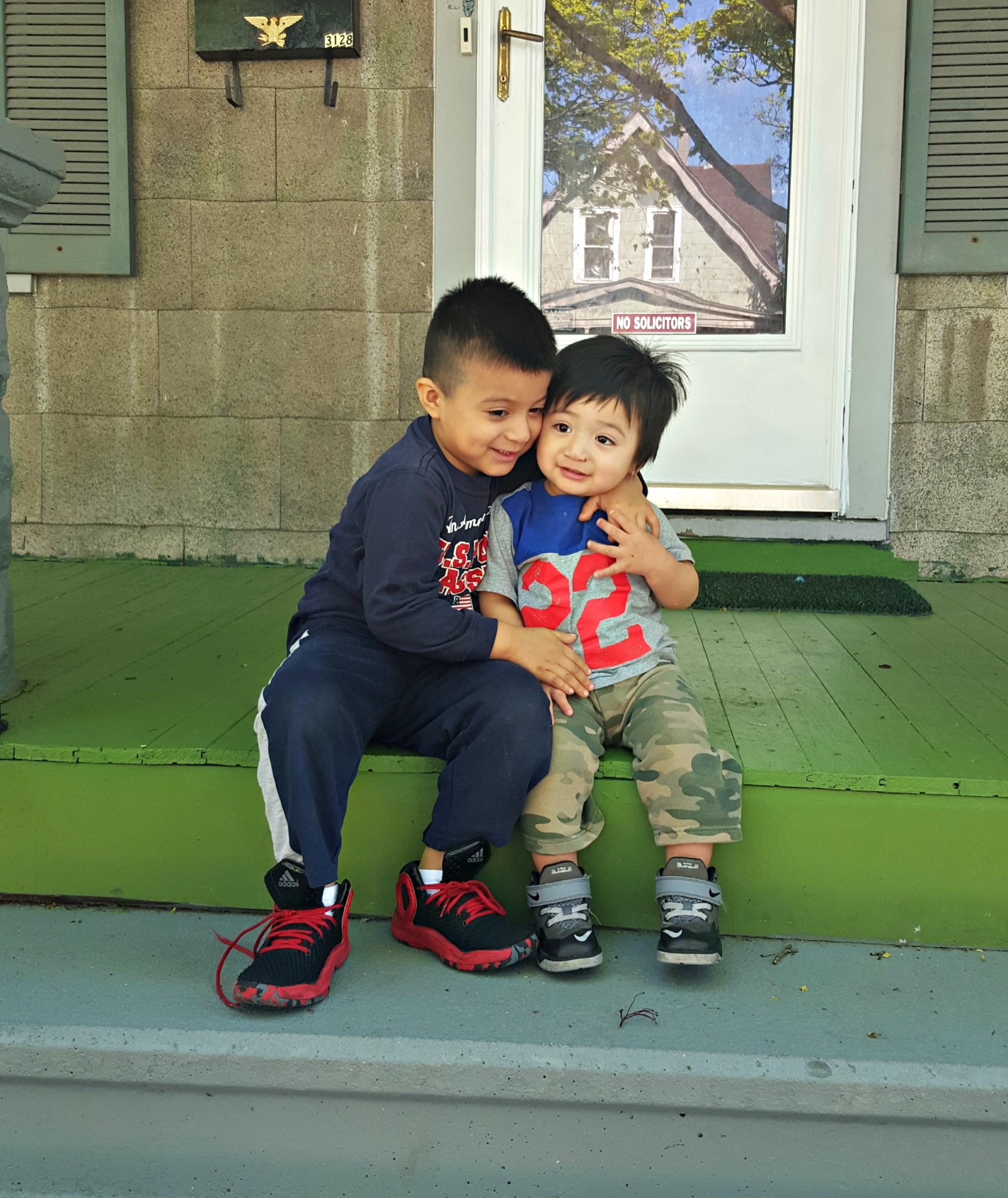 Martin and Angel play on the front porch of their new home and pose for a quick photo.