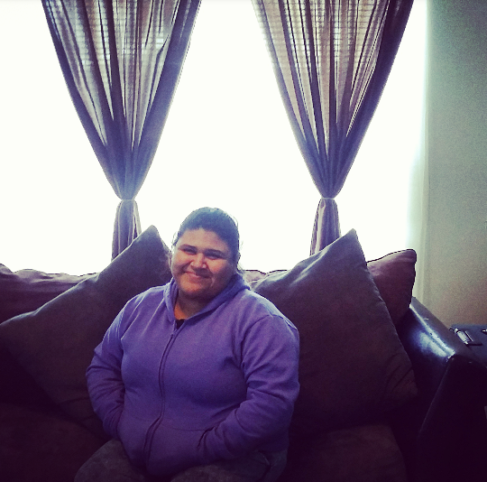 Esperanza in her newly remodeled living room